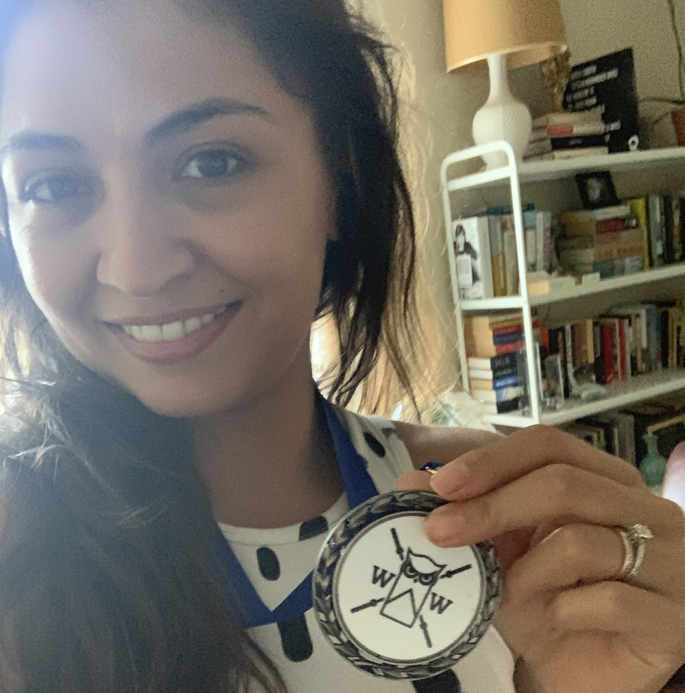 roni holding a weightlifting medal